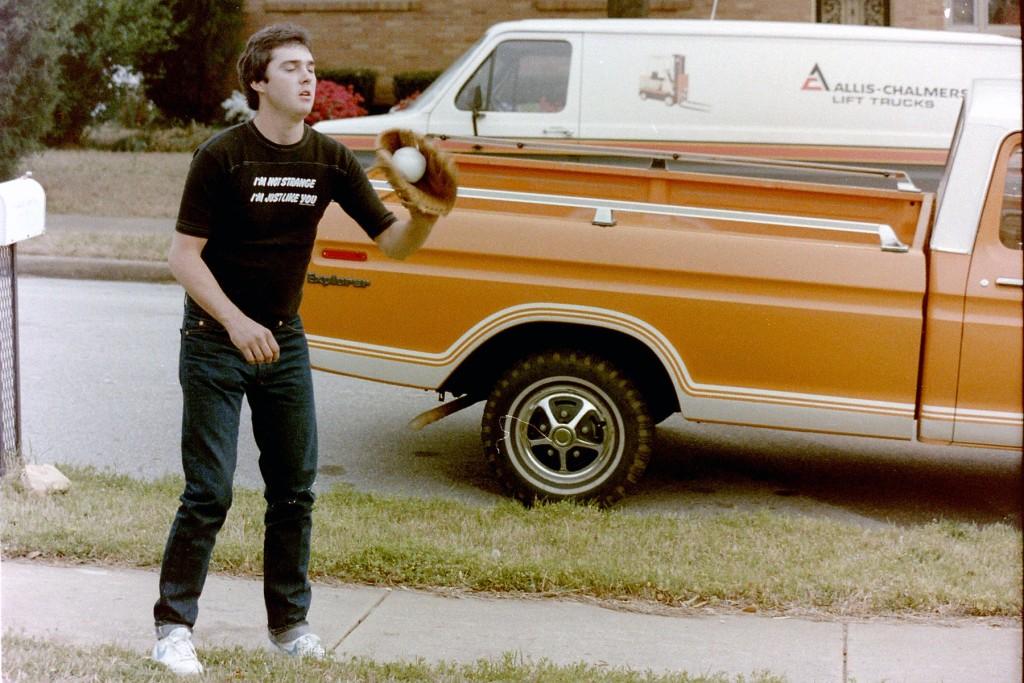 A fan (Bobby East) wearing an early '80s I'm Not Strange T Shirt